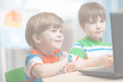 Two little kids watching to a laptop